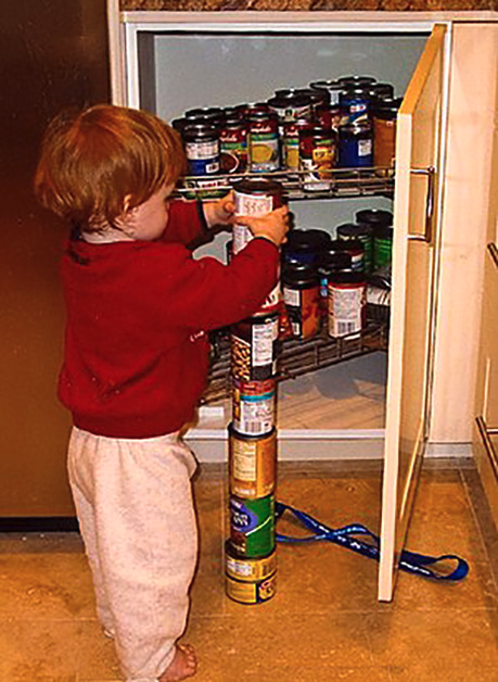 child stacking cans